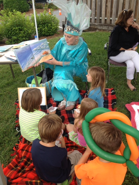 Heather Rhyne dressed as fish, storytelling at the Albert Carlton Library festivities