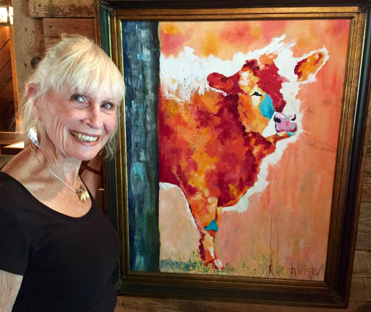 Photograph of artist Penny Bradley at her easel