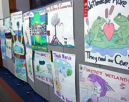 Macon County Library display wall with student art